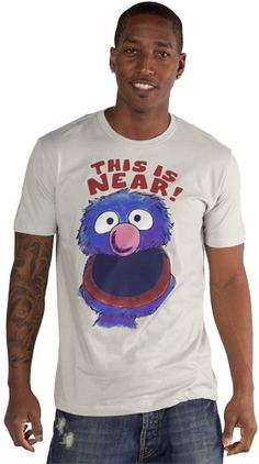 This Near and Far Grover shirt refers to the skit on Sesame Street where Grover was teaching the differences between near and far, but it ended up with him getting winded and falling down tired.