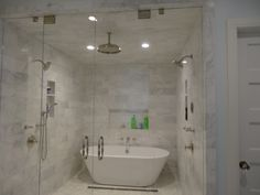 Steam shower with marble tiles. Swing in and out doors with a bathtub inside!