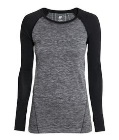 Long-sleeved, seamless base layer top in fast-drying, functional fabric with thumb holes at cuffs. Grey melange, with black raglan sleeves. | H&M Sport