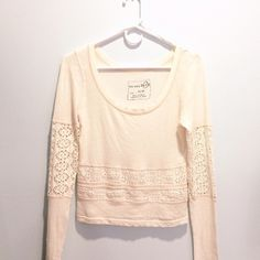Free People White Eyelet Crop Top Perfect condition; has lace mid waist and arm sleeves.  This top is a light weight top in a creamy ivory color. Free People Tops Tees - Long Sleeve