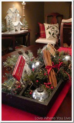 Table centerpiece = cinnamon sticks, a book to read, greenery . .