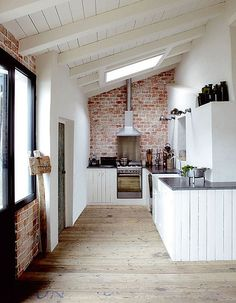 your kitchen a modern feel by putting in a brick accent wall. Get this look with our Carriage House Brick panels! #kitchen http://www.decpanels.com/products/earth-stones