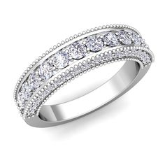 Vintage Inspired Diamond Wedding Ring Band in Platinum. This gorgeous platinum wedding ring sparkling diamonds set in a milgrain ring band. What a beautiful vintage inspired diamond ring to be a wedding band or anniversary ring.