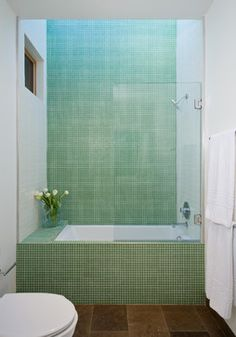 Green tile is trending in interior design. Here are 35 reasons why we can't get enough green tile. For more interior design trends and inspiration, visit domino. Tub Shower Combo, Shower Tub, Shower Faucet, Shower Doors, Bathroom Renos, Bathroom Interior, Bathroom Ideas, Bathroom Makeovers, Bathroom Renovations
