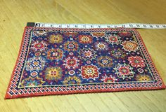 Mini carpet embroidered with small point