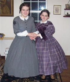 Two pre-teen sisters wearing more grownup style dresses with fitted bodices  and hoop skirts but still retaining the shorter skirts of youth. 0a305d61a223