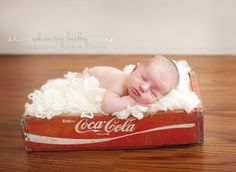 Newborn photo in coca-cola crate...great with this baby, since I seem to be addicted to the stuff this pregnancy.