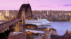 a cruise ship passes under Sydney Harbour Bridge - Sydney, NSW