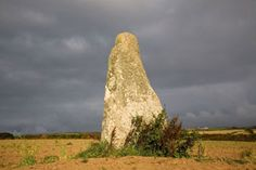 Blind Fiddler - near Penzance, Cornwall, England;  a menhir over 10 feet high with a distinctive triangular shape;  it measures over 6 feet wide at the base and becomes slimmer as the top;  folklore says it was a musician who was turned to stone for playing music on the Sabbath