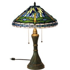 @Overstock.com - Tiffany Style Dragonfly Table Lamp - This table lamp features handcrafted glass created in rich jewel tones. Made with 30 jewels and 324 hand-cut pieces of glass wrapped in fine copper foil, this lamp uses the technique developed by Louis Comfort Tiffany in the early 1900s.  http://www.overstock.com/Home-Garden/Tiffany-Style-Dragonfly-Table-Lamp/7542445/product.html?CID=214117 $127.99