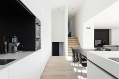 Tagged: Kitchen, White Cabinet, Light Hardwood Floor, and Wall Oven. Photo 4 of 11 in 10 Minimalist and Monochromatic Homes in Belgium from Home DW by Francisca Hautekeete. Browse inspirational photos of modern kitchens. Minimalist Architecture, Interior Architecture, Light Hardwood Floors, Home Modern, Minimalist Home Decor, Prefab Homes, Deco Design, Kitchen Interior, Modern Interior Design