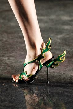 Prada Heels from the 2012 Spring Collection. Not sure on the cost or where you would possibly wear them but they are so neat looking. Very Hermes-esque (the god, not the brand)