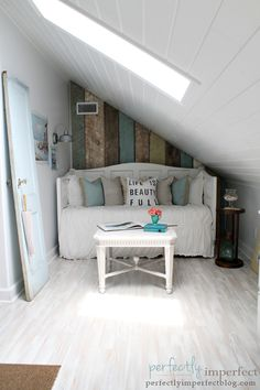 What a sweet attic nook by Perfectly Imperfect!  The distressed plank wall is the perfect touch!