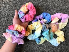 Beautiful tie dye scrunchies.  Each one is different and you will not get 2 that are the same.These are handmade from brand new very soft tie-dye fabrics and very strong stretchy elastic band.The price is for each scrunchy, great for daily wear, gifts, party favors, etc...You will get a random color similar to the ones in the pictures. We have other cute itesms, check out our shop.  AndMonsterToys.etsy.comSHIPPING DISCOUNTS WILL AUTOMATICALLY CALCULATED DURING CHECK-OUT. Tie Dye Hair, Hair Ties, Dyed Hair, Elephant Baby Decor, Elephant Fabric, How To Tie Dye, Tie And Dye, Tie Dye Fashion, Diy Fashion