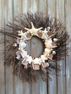 Hey, I found this really awesome Etsy listing at http://www.etsy.com/listing/120245839/feathered-sea-shell-wreath-with-starfish