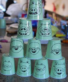 Angry Birds: Buy green cups, print out pig faces (save time), then add them to the wood pieces to knock down with bean bags.