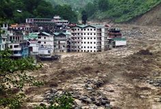 Buildings are partly submerged in the flooded Alaknanda River in Govind Ghat, India, on June 18, 2013. (AP Photo) #