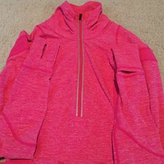LULULEMON Zip Up Pullover Heather pink, very soft and stretchy, rouched neckline, mid-neck turtle neck when zipped all the way up, lulu thumb holes with fold over finger warmers. 2 pockets in front, 1 in the back. Very flattering for the bust and waistline. In great condition. trades PayPal lululemon athletica Sweaters