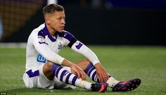 Gayle pictured sitting on the turf during the tie at the KCOM Stadium as Newcastle looked to cause an upset