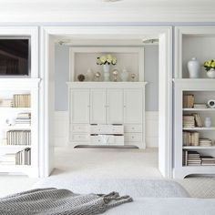 entryway idea for dressing room...use glass doors and transom windows.  but utilize space wall space with shelving into bedroom