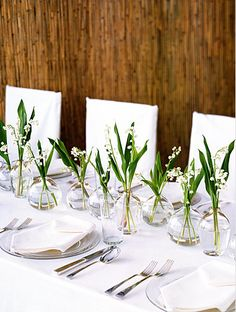 Inexpensive table centerpieces - Use bud vases and grocery store flowers.
