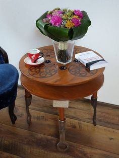 Cable reel coffe table decorated with an oriental motif and metal legs. Cable Reel, Coffe Table, Repurposed, Oriental, Iron, Legs, Table Decorations, Coffee, Metal