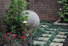 The look of a concrete ball in the garden.