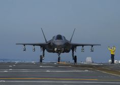 PACIFIC OCEAN (Nov. 4, 2016) A Sailor directs F-35B Lightning II aircraft on the flight deck of amphibious assault ship USS America (LHA 6) during flight operations. The F-35B short takeoff/vertical landing (STOVL) variant is the world's first supersonic STOVL stealth aircraft.