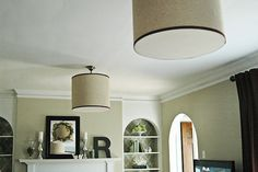 Change your light fixture...and not permanently!  Cover it with a drum shade you can make.