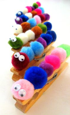 These caterpillars are super cute and perfect for containing all of my girls accumulated papers in one spot. Just run a line of glue down the top of the clothes pin and let the kids stick on the po…
