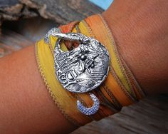 STERLING Silver Silk Ribbon Bracelet, Honey Bee Jewelry, Yoga Wrist Wrap Bracelet, Sterling Silver Toggle Clasp, Citrine Buttercup Yellow. $49.95, via Etsy.