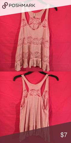 Light pink flowy racerback tank w/ floral lace A light pink, flowy, tank perfect for a summer day at the beach over a bathing suit or for a day at work over a cami. Very comfortable. A size small, but fits me well and I'm usually a medium. Tops Tank Tops