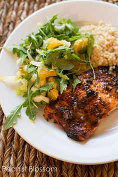 Mustard glazed salmon with citrus salad featuring arugula and oranges. Awesome healthy meal, husband approved!