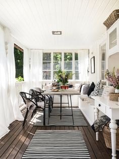 very beautiful covered porch in black and white
