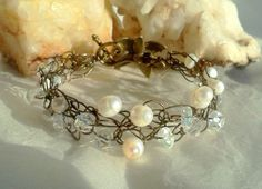 Pearl and Crystal Bracelet Brass Wire Crochet by SomethingSeaBlue, $35.00   Oh JUST POPPY =)