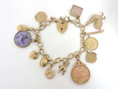 A 9ct gold charm bracelet. Sold for £280