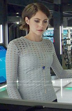 Thea's grey perforated long sleeve top on Arrow. Outfit Details: https://wornontv.net/57283/ #Arrow