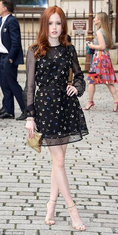 Redhead actress Ellie Bamber kept it simple in a black mini