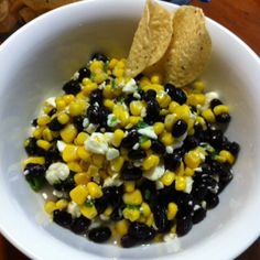 Black Bean, Corn & Feta Dip (2 cans of black beans, 2 cans of corn, 8 oz feta cheese, 1 bundle of green onions, garlic powder, olive oil, apple cider vinegar, and sugar - Mix all ingredients together and refrigerate for at least 2 hours before serving.