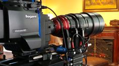 Optimo 28-340 on Ikegami booth