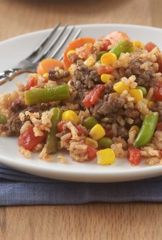 Lean beef, brown rice, vegetables and juicy tomatoes make a delicious one-skillet dish