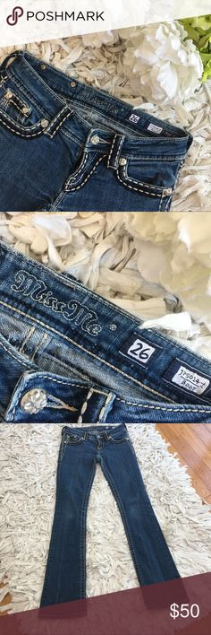 👖MISS ME JEANS👖SIZE 26 DARK WASH BOOT CUT JEANS Beautiful Miss Me size 26 boot cut jeans with gorgeous stitching!. One leg has a tear on it on the bottom, I purchased them this way and they fit amazing (true to size). PLEASE ASK ALL QUESTIONS BEFORE MAKING AN OFFER OR PURCHASE. Kept in a smoke and pet free environment. Taking all reasonable offers ♥️ Miss Me Jeans