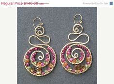 Hey, I found this really awesome Etsy listing at https://www.etsy.com/listing/88681679/sale-swirl-drop-earrings-ruby-citrine