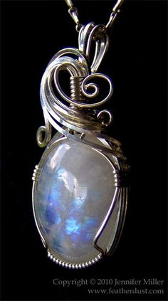 a moonstone carefully hand wrapped in Argentium sterling silver.