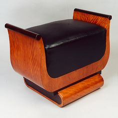 An Art Deco bench made of amaranth and ebony wood, upholstered in black leather and originally from Austria.