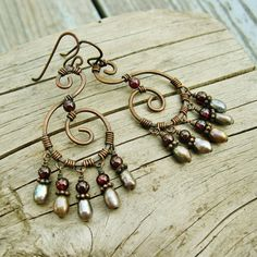 Hammered Copper Swirls with Garnets and freshwater pearls dangle earrings wire wrapped by BearRunOriginals on Etsy.