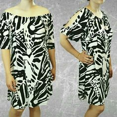 """//SALE//  Cold Shoulder Black/White Abstract Dress Worn off the shoulder or as a cold shoulder,  elastic neckline, A-line style, mid length,  abstract black and white design. Polyester for a silky, comfortable wear.  Size 12. Measurements: Bust 36"""". Waist 40"""". Dress length 32"""". All measurements are flat lay.  Preloved in great condition. AGB Dresses Midi"""