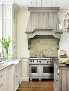 Create a stunning focal point in an otherwise monochromatic kitchen with an oversize or colorful range hood! Find more looks here: http://www.bhg.com/kitchen/remodeling/planning/kitchen-remodeling-tips/?socsrc=bhgpin120214wowrangehood&page=13