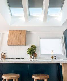 Create a centrepiece in your kitchen extension with a combination of VELUX pitched roof windows. These three work fantastically with the grey blinds and the wood, which features prominently. Skylight Design, Ceiling Design, Honeycomb Blinds, Roof Window, Kitchen Gallery, Roof Light, Home Kitchens, Kitchen Skylights, Kitchen Ideas