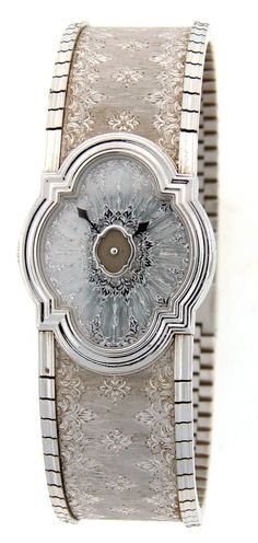 "Gianmaria Buccellati 18K White Gold Ladies Watch Limited Edition - there were only 100 items made and this particular piece is #007. There is a ""Gianmaria Buccellati"" maker's mark, a hallmark for 18k gold, model name, number and a number 7 out of 100 made engraved inside of the ring Fits up to 7"" wrist Weight: 99.3 grams"